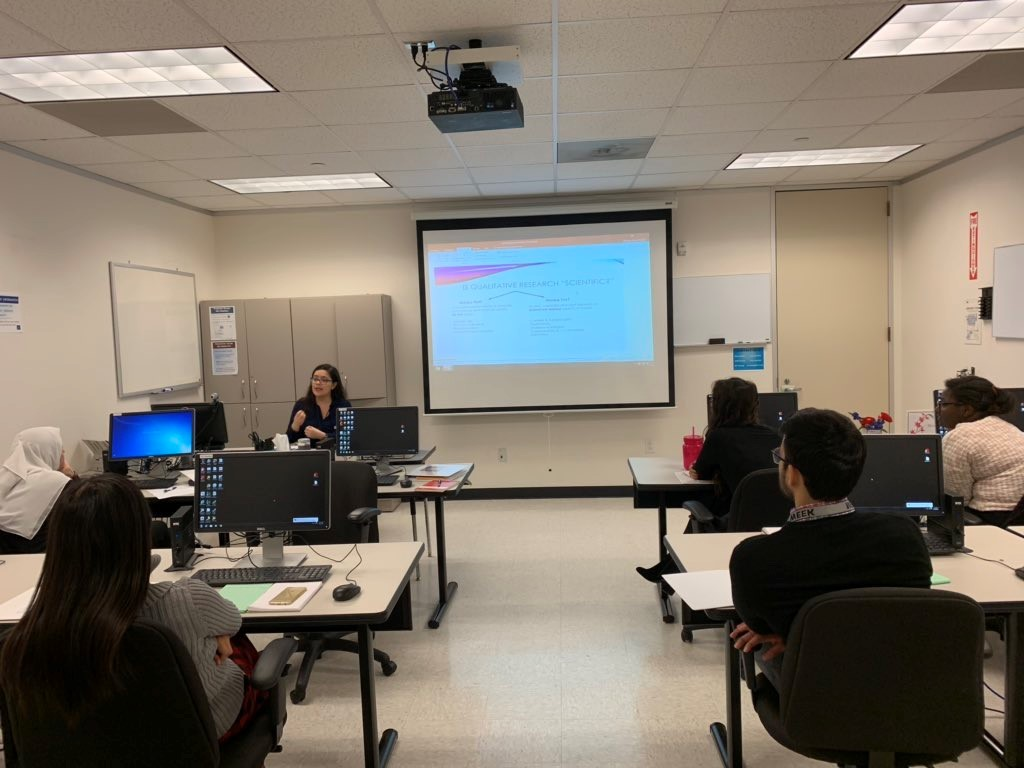 Lab member Maria Priscilla conducts a training session for Hoda Badr lab on qualitative analysis.