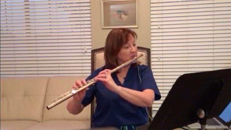 Dr. Lynn Zechiedrich playing flute
